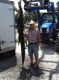 Chuck Hallier 9 foot Alligator taken with his bow.